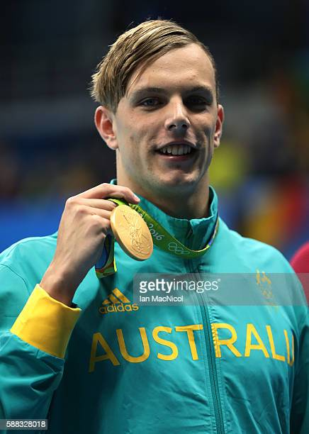 Kyle Chalmers of Australia poses with his gold medal from the Men's 100m Freestyle on Day 5 of the Rio 2016 Olympic Games at the Olympic Aquatics...