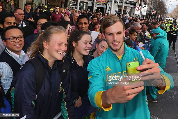 Kyle Chalmers poses with fans during the Australian Olympic Team Melbourne Welcome Home Celebration at Bourke Street on August 31 2016 in Melbourne...