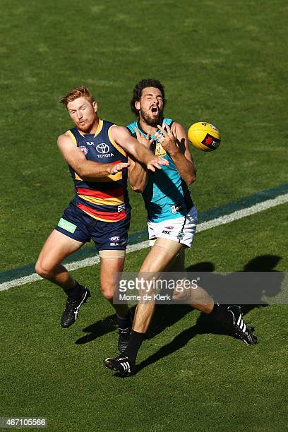 Kyle Cheney of the Crows spoils a mark by John Butcher of the Power during the NAB Challenge AFL match between the Port Adelaide Power and the...