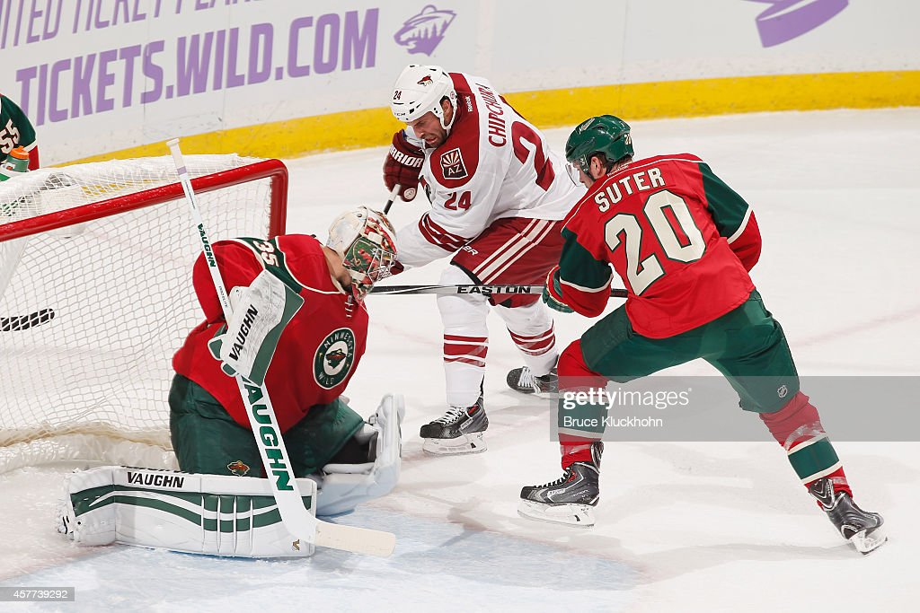 Kyle Chipchura of the Arizona Coyotes attempts to score with Ryan Suter and goalie Darcy Kuemper of the Minnesota Wild defending during the game on...