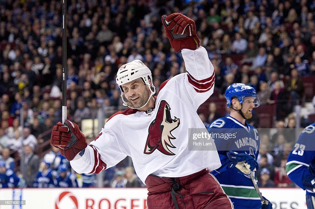 <a gi-track='captionPersonalityLinkClicked' href=/galleries/search?phrase=Kyle+Chipchura&family=editorial&specificpeople=879784 ng-click='$event.stopPropagation()'>Kyle Chipchura</a> #24 of the Phoenix Coyotes celebrates after scoring an empty net goal while <a gi-track='captionPersonalityLinkClicked' href=/galleries/search?phrase=Henrik+Sedin&family=editorial&specificpeople=202574 ng-click='$event.stopPropagation()'>Henrik Sedin</a> #33 of the Vancouver Canucks skates past in the background during the third period in NHL action on February 26, 2013 at Rogers Arena in Vancouver, British Columbia, Canada.