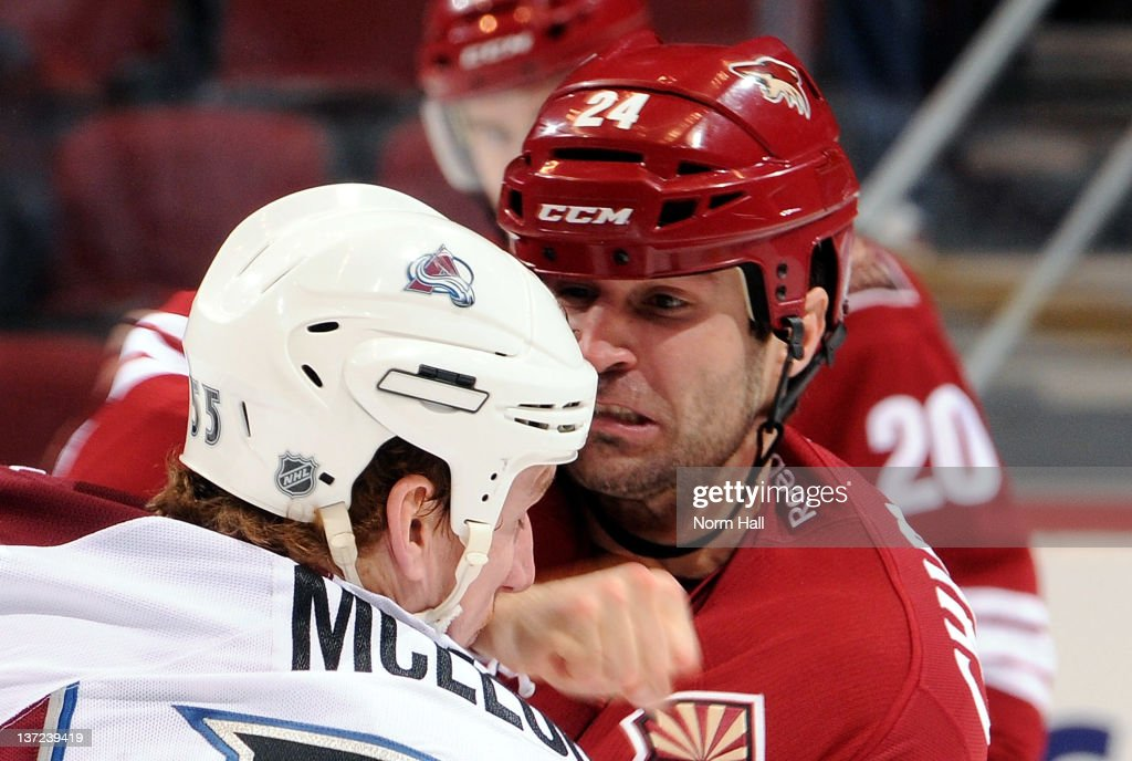 Kyle Chipchura of the Phoenix Coyotes connects with a right hook on Cody McLeod of the Colorado Avalanche at Jobingcom Arena on January 16 2012 in...