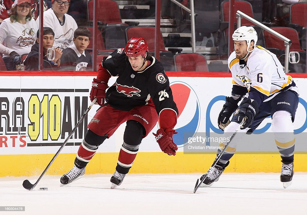 <a gi-track='captionPersonalityLinkClicked' href=/galleries/search?phrase=Kyle+Chipchura&family=editorial&specificpeople=879784 ng-click='$event.stopPropagation()'>Kyle Chipchura</a> #24 of the Phoenix Coyotes skates with the puck past <a gi-track='captionPersonalityLinkClicked' href=/galleries/search?phrase=Shea+Weber&family=editorial&specificpeople=554412 ng-click='$event.stopPropagation()'>Shea Weber</a> #6 of the Nashville Predators during the NHL game at Jobing.com Arena on January 28, 2013 in Glendale, Arizona. The Coyotes defeated the Predators 4-0.