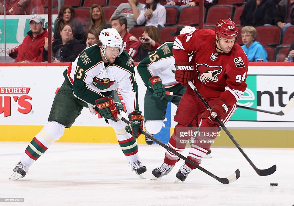 <a gi-track='captionPersonalityLinkClicked' href=/galleries/search?phrase=Kyle+Chipchura&family=editorial&specificpeople=879784 ng-click='$event.stopPropagation()'>Kyle Chipchura</a> #24 of the Phoenix Coyotes skates with the puck under pressure from <a gi-track='captionPersonalityLinkClicked' href=/galleries/search?phrase=Dany+Heatley&family=editorial&specificpeople=202142 ng-click='$event.stopPropagation()'>Dany Heatley</a> #15 of the Minnesota Wild during the NHL game at Jobing.com Arena on February 28, 2013 in Glendale, Arizona. The Wild defeated the Coyotes 4-3.