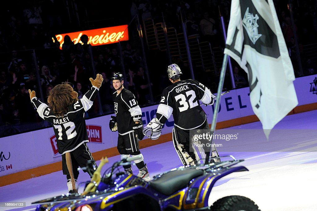 Kyle Clifford #13, Jonathan Quick #32 and mascot Bailey of the Los Angeles Kings acknowledge the crowd after defeating the Columbus Blue Jackets at Staples Center on April 18, 2013 in Los Angeles, California.