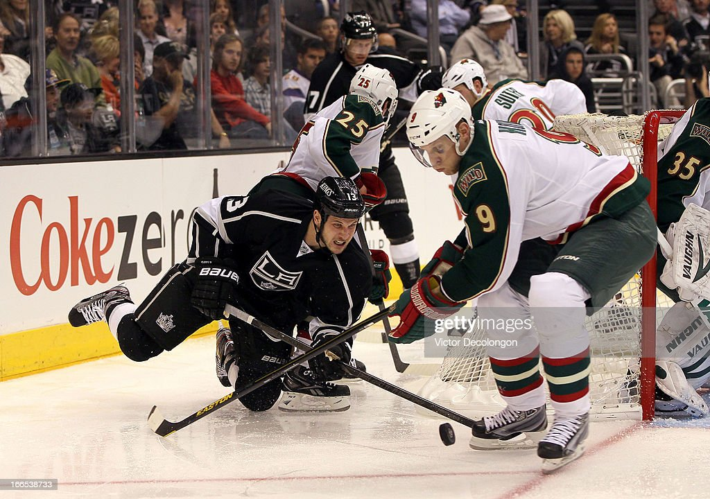 <a gi-track='captionPersonalityLinkClicked' href=/galleries/search?phrase=Kyle+Clifford&family=editorial&specificpeople=4640225 ng-click='$event.stopPropagation()'>Kyle Clifford</a> #13 of the Los Angeles Kings and <a gi-track='captionPersonalityLinkClicked' href=/galleries/search?phrase=Mikko+Koivu&family=editorial&specificpeople=584987 ng-click='$event.stopPropagation()'>Mikko Koivu</a> #9 of the Minnesota Wild vie for the puck near the Wild net during the second period of their NHL game at Staples Center on April 4, 2013 in Los Angeles, California. The Kings defeated the Wild 3-0.