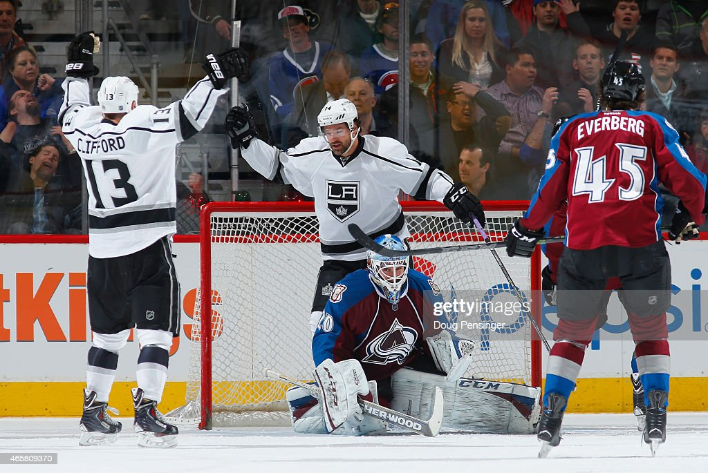<a gi-track='captionPersonalityLinkClicked' href=/galleries/search?phrase=Kyle+Clifford&family=editorial&specificpeople=4640225 ng-click='$event.stopPropagation()'>Kyle Clifford</a> #13 of the Los Angeles Kings celebrates his goal against goalie <a gi-track='captionPersonalityLinkClicked' href=/galleries/search?phrase=Reto+Berra&family=editorial&specificpeople=570422 ng-click='$event.stopPropagation()'>Reto Berra</a> #20 of the Colorado Avalanche with teammates <a gi-track='captionPersonalityLinkClicked' href=/galleries/search?phrase=Justin+Williams+-+Ice+Hockey+Player&family=editorial&specificpeople=201745 ng-click='$event.stopPropagation()'>Justin Williams</a> #14 of the Los Angeles Kings as <a gi-track='captionPersonalityLinkClicked' href=/galleries/search?phrase=Dennis+Everberg&family=editorial&specificpeople=13469265 ng-click='$event.stopPropagation()'>Dennis Everberg</a> #45 of the Colorado Avalanche looks on as the Kings take a 4-1 lead in the second period at Pepsi Center on March 10, 2015 in Denver, Colorado.