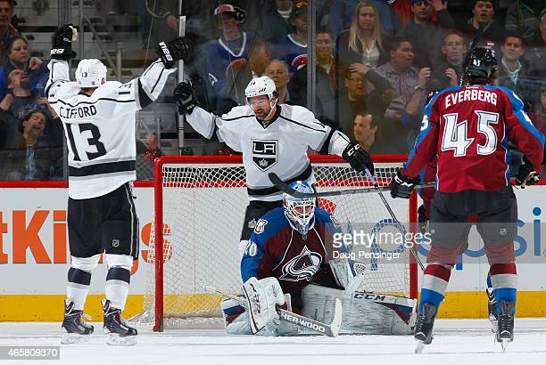 Kyle Clifford of the Los Angeles Kings celebrates his goal against goalie Reto Berra of the Colorado Avalanche with teammates Justin Williams of the...