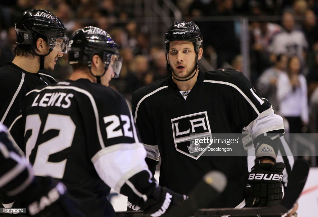 Kyle Clifford #13 of the Los Angeles Kings (R)looks on during the NHL game against Columbus Blue Jackets at Staples Center on February 15, 2013 in Los Angeles, California. The Kings defeated the Blue Jackets 2-1.