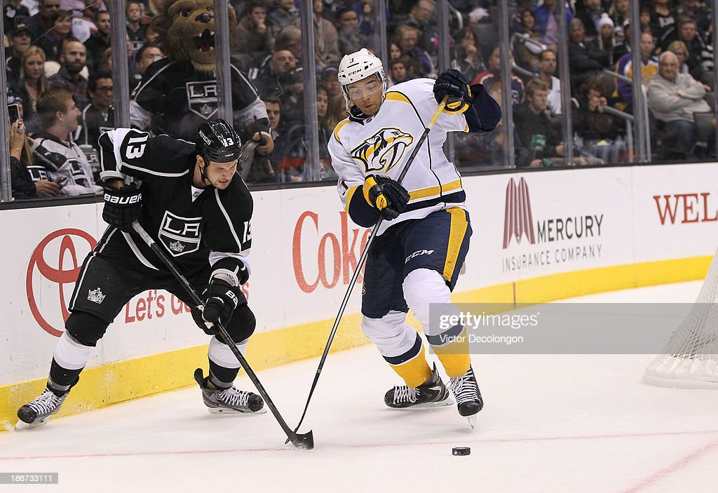 <a gi-track='captionPersonalityLinkClicked' href=/galleries/search?phrase=Kyle+Clifford&family=editorial&specificpeople=4640225 ng-click='$event.stopPropagation()'>Kyle Clifford</a> #13 of the Los Angeles Kings plays the puck from Seth Jones #3 of the Nashville Predators in the second period during their NHL game at Staples Center on November 2, 2013 in Los Angeles, California. The Predators defeated the Kings 4-3.