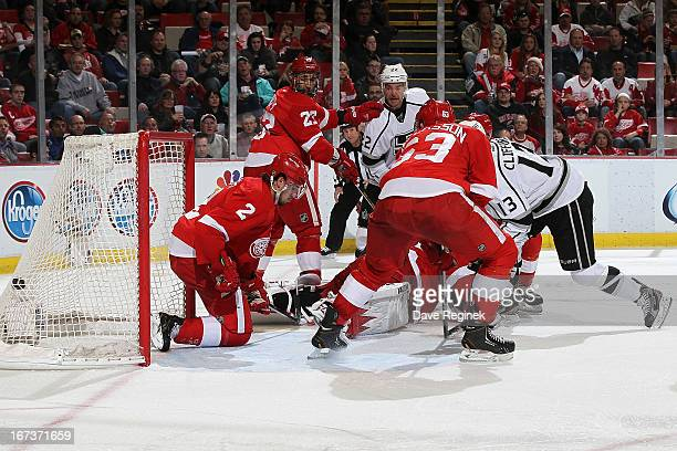 Kyle Clifford of the Los Angeles Kings scores a shot past Jimmy Howard Kyle Quincy Joakim Andersson and Brendan Smith of the Detroit Red Wings during...
