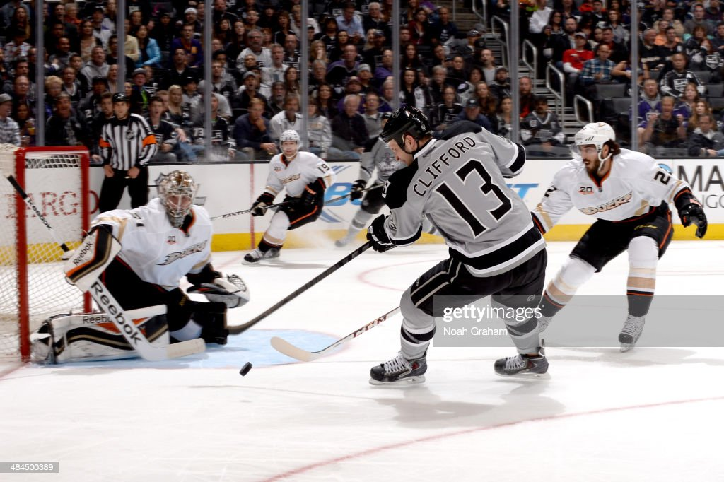 Kyle Clifford #13 of the Los Angeles Kings shoots the puck against Frederik Andersen #31 of the Anaheim Ducks at Staples Center on April 12, 2014 in Los Angeles, California.
