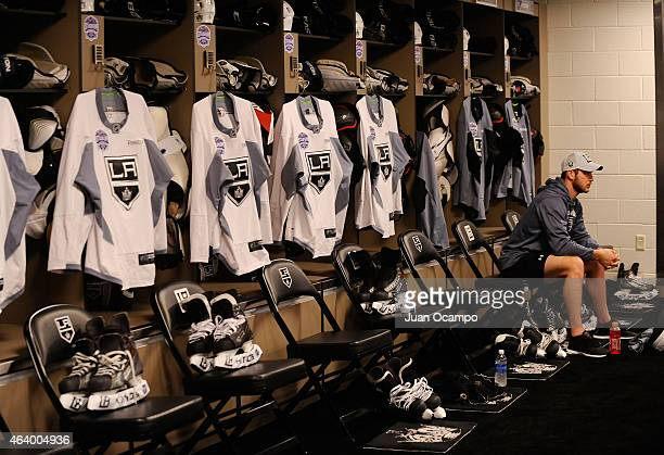 Kyle Clifford of the Los Angeles Kings waits to put on his equipment in the locker room before practice a day before the 2015 Coors Light Stadium...