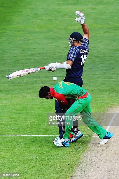 Kyle Coetzer of Scotland runs in to Sabbir Rahman of Bangladesh during the 2015 ICC Cricket World Cup match between Bangladesh and Scotland at Saxton...