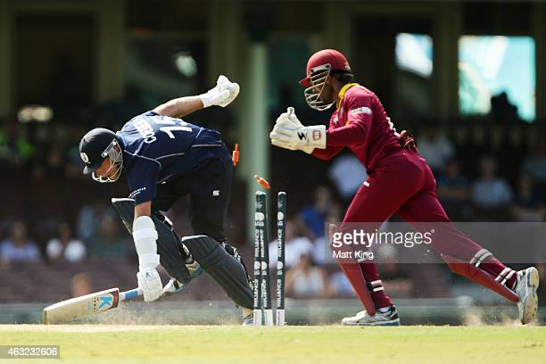 Kyle Coetzer of Scotland slides in to avoid a runout during the ICC Cricket World Cup warm up match between the West Indies and Scotland at Sydney...