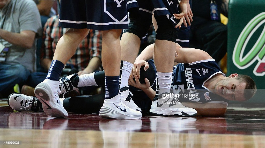 Kyle Collinsworth #5 of the Brigham Young Cougars holds his knee after injuring it during the championship game of the West Coast Conference Basketball tournament against the Gonzaga Bulldogs at the Orleans Arena on March 11, 2014 in Las Vegas, Nevada. Gonzaga won 75-64.