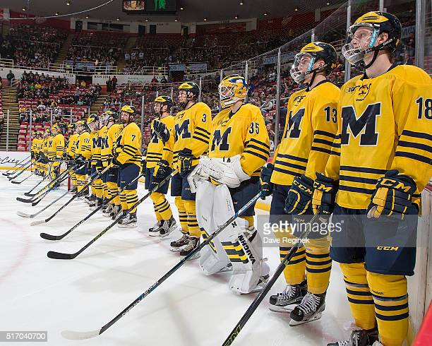 Kyle Connor and Zach Werenski and the rest of the Michigan Wolverines stand on the goal line before the 'Dual in the D' inaugural game against the...