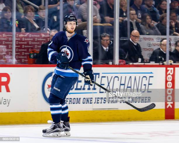 Kyle Connor of the Winnipeg Jets keeps an eye on the play during first period action against the Nashville Predators at the MTS Centre on April 8...
