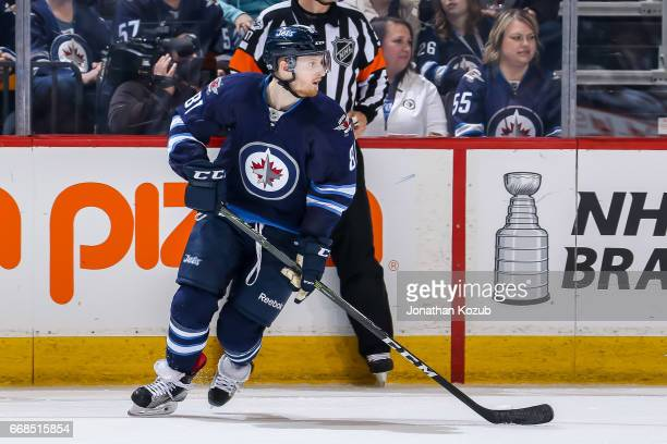 Kyle Connor of the Winnipeg Jets keeps an eye on the play during third period action against the Nashville Predators at the MTS Centre on April 8...