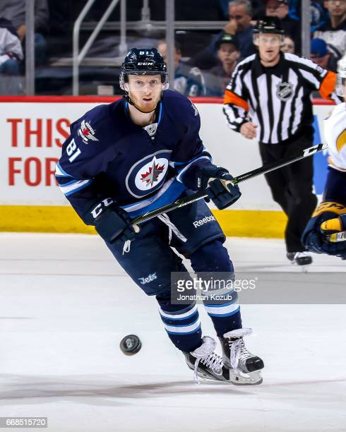 Kyle Connor of the Winnipeg Jets keeps an eye on the puck during third period action against the Nashville Predators at the MTS Centre on April 8...