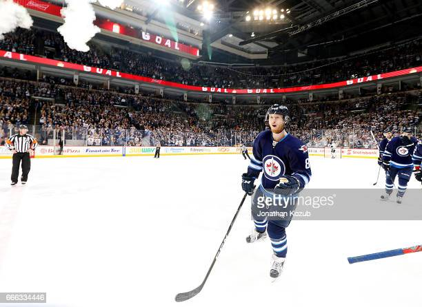 Kyle Connor of the Winnipeg Jets skates to the bench to celebrate after scoring a third period goal against the Nashville Predators at the MTS Centre...