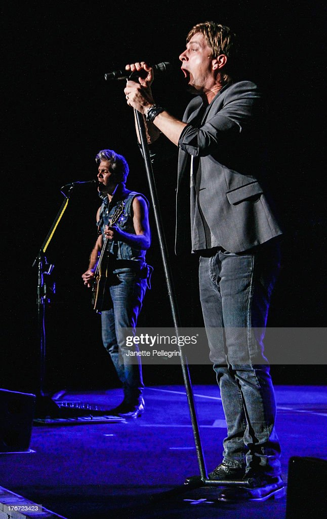 Kyle Cook and Rob Thomas of Matchbox Twenty perform at Nikon at Jones Beach Theater on August 17, 2013 in Wantagh, New York.