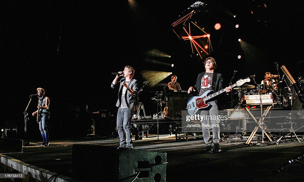 Kyle Cook, Rob Thomas and Brian Yale of Matchbox Twenty perform at Nikon at Jones Beach Theater on August 17, 2013 in Wantagh, New York.