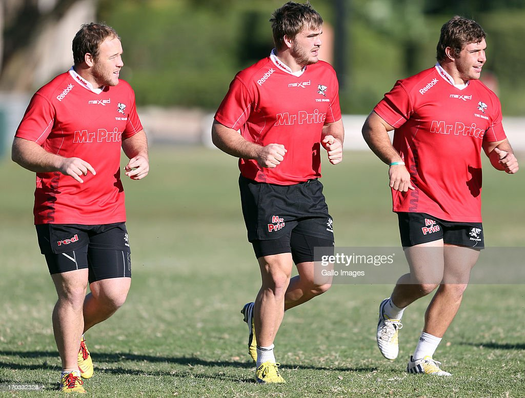 Kyle Cooper with Dale Chadwick and Wiehahn Herbst of the Sharks during The Sharks training session at Growthpoint Kings Park on June 11, 2013 in Durban, South Africa.