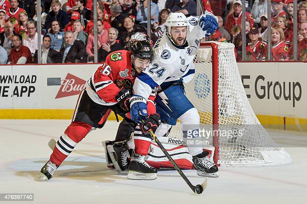 Kyle Cumiskey of the Chicago Blackhawks and Ryan Callahan of the Tampa Bay Lightning chase the puck during Game Three of the 2015 NHL Stanley Cup...