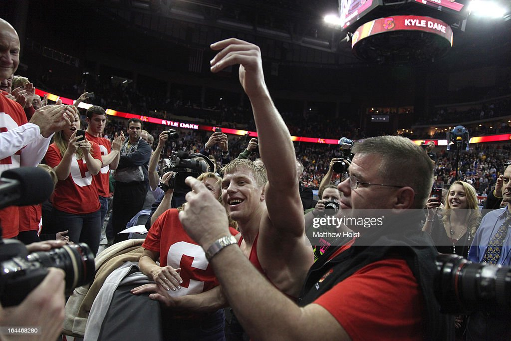 Kyle Dake of the Cornell Big Red celebrates with fans after his victory over David Taylor of the Penn State Nittany Lions in the 165-pound championship match at the 2013 NCAA Wrestling Championships on March 23, 2013 at Wells Fargo Arena in Des Moines, Iowa.