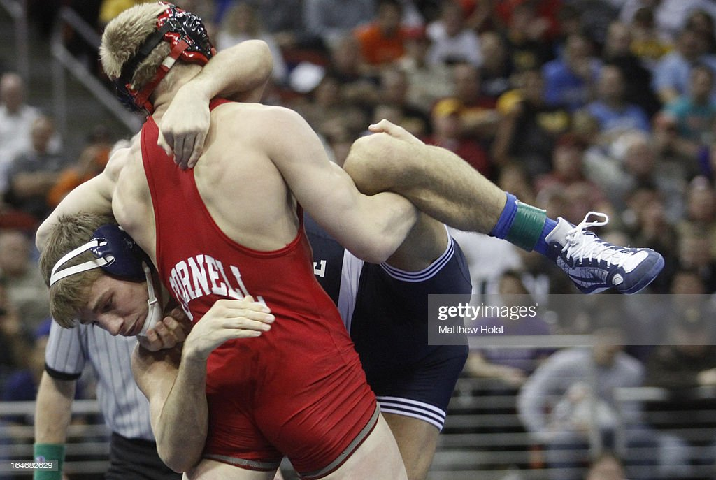 Kyle Dake of the Cornell Big Red wrestles David Taylor of the Penn State Nittany Lions in the 165-pound championship match at the 2013 NCAA Wrestling Championships on March 23, 2013 at Wells Fargo Arena in Des Moines, Iowa.
