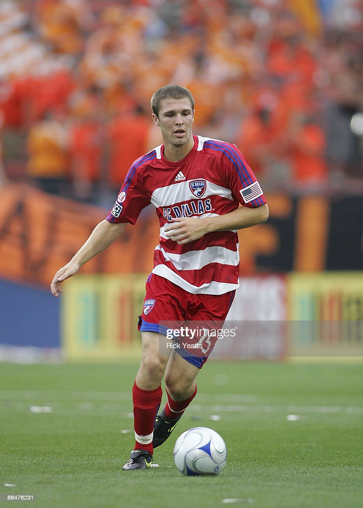 Kyle Davies #15 of the FC Dallas runs with the ball at Pizza Hut Park on June 13, 2009 in Frisco, Texas.