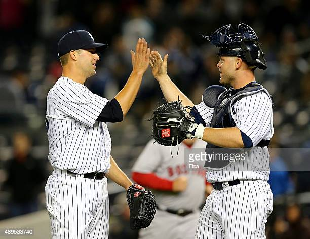 Kyle Davies of the New York Yankees celebrates the win with teammate Brian McCann after the game against the Boston Red Sox on April 12 2015 at...