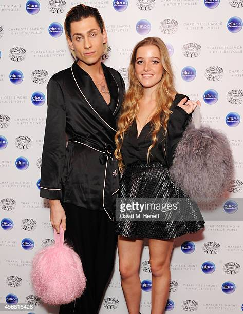 Kyle De'volle and Charlotte Simone attend the Charlotte Simone x Kyle De'volle Bon Bon Bag launch at Steam Rye on November 11 2014 in London England