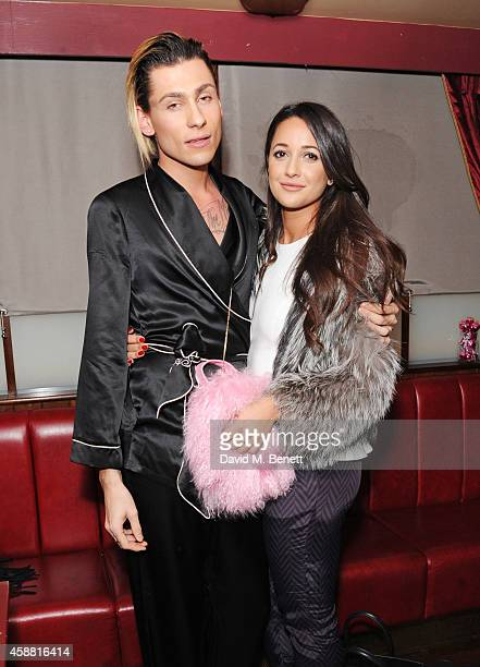 Kyle De'volle and Roxie Nafousi attend the Charlotte Simone x Kyle De'volle Bon Bon Bag launch at Steam Rye on November 11 2014 in London England