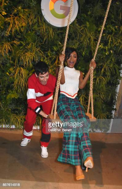 Kyle De'Volle pushes Jourdan Dunn on a swing at Google's Pixel 2 phone launch at The Old Selfridges Hotel on October 4 2017 in London England