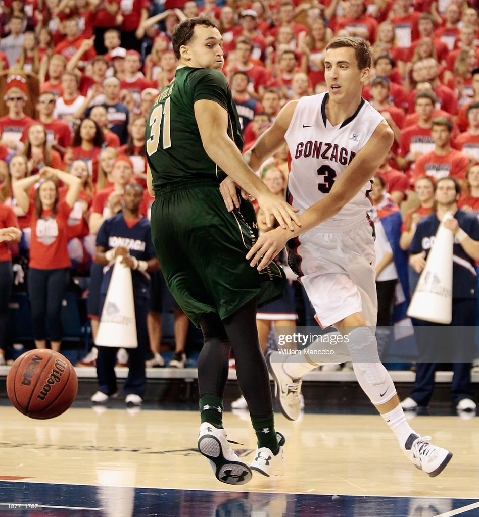 Kyle Dranginis #3 of the Gonzaga Bulldogs bounce passes the ball behind defender J.J. Avila #31 of the Colorado State Rams during the second half of the game at McCarthey Athletic Center on November 11, 2013 in Spokane, Washington.