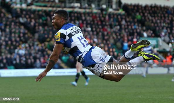 Kyle Eastmond of Bath dives over for the first try during the Aviva Premiership match between Northampton Saints and Bath at Franklin's Gardens on...