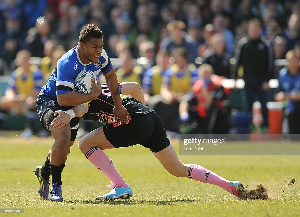 Kyle Eastmond (L) of Bath is tackled by Hugo Bonneval of Stade Francais during the Amlin Challenge Cup Quarter Final match between Bath and Stade Francais at the Recreation Ground on April 06, 2013 in Bath, England.