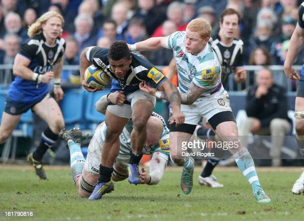 Kyle Eastmond of Bath is tackled by Tom Homer during the Aviva Premiership match between Bath and London Irish at the Recreation Ground on February...