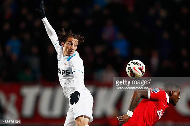 Kyle Ebecilio of Twente and Andres Guardado of PSV leap for the header during the Dutch Eredivisie match between FC Twente and PSV Eindhoven held at...