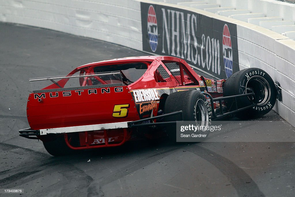 Kyle Ebersole, driver of the #5 Ebersole Excavating Ford, hits the wall during the NASCAR Whelen Modified Tour Town Fair Tire 100 at New Hampshire Motor Speedway on July 13, 2013 in Loudon, New Hampshire.