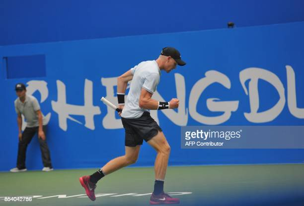 Kyle Edmund of Britain reacts after a point against Bernard Tomic of Australia during their men's singles first round match at the ATP Chengdu Open...