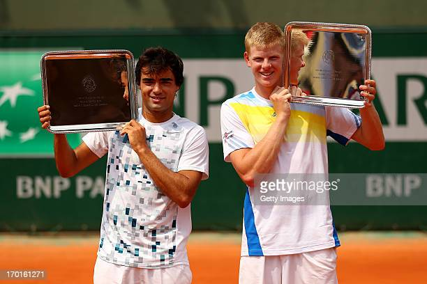 Kyle Edmund of Great Britain and Frederico Ferreira Silva of Portugal pose with their trophies after the boys' doubles final match against Christian...
