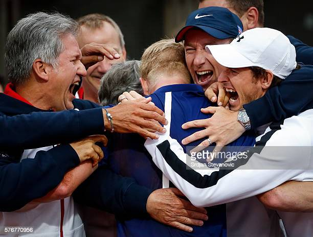Kyle Edmund of Great Britain celebrate victory with the Andy Murray and his team mates after day three of the Davis Cup Quarter Final match between...