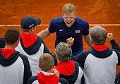 Kyle Edmund of Great Britain celebrates victory with the team mates after day three of the Davis Cup Quarter Final match between Serbia and Great...