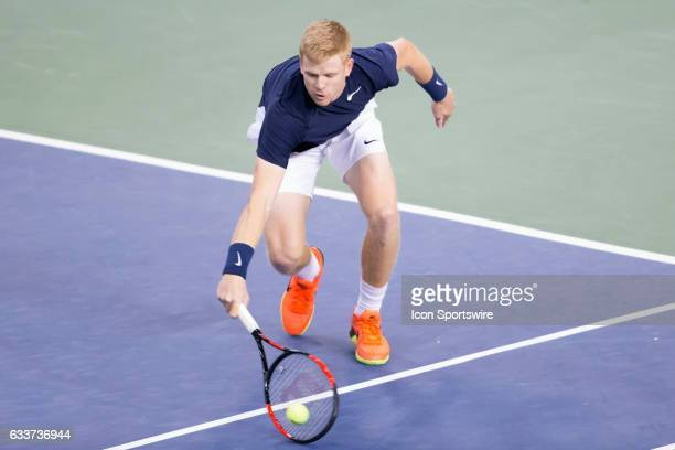 Kyle Edmund of Great Britain dives for a volley against Vasek Pospisil of Canada in the BNP Paribas Davis Cup Tennis Canada v Great Britain team...