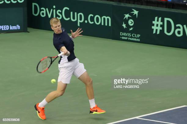 Kyle Edmund of Great Britain hits a ball during the first set against Denis Shapovalov of Canada on the third day of Davis Cup first round play...