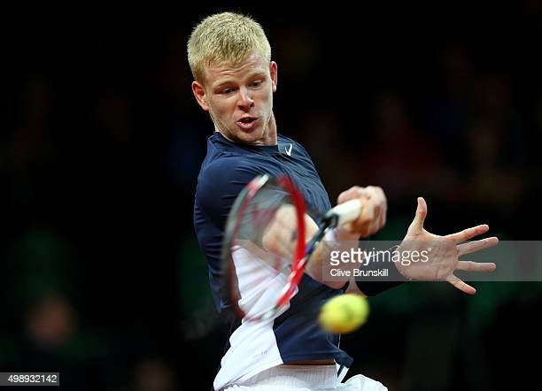 Kyle Edmund of Great Britain hits a forehand during the singles match against David Goffin of Belgium on day one of the Davis Cup Final 2015 at...