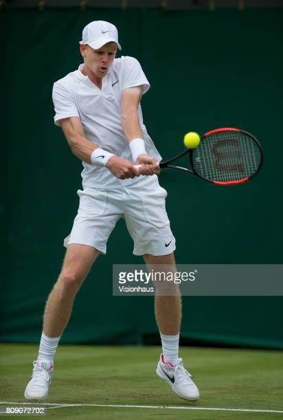 Kyle Edmund of Great Britain in action against Alexander Ward of Great Britain on day two of the Wimbledon Lawn Tennis Championships at the All...